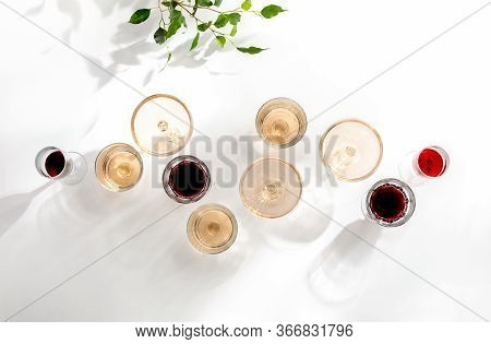 Rose Wine Assortment, Top-down View Of Various Wine Glasses Full Of Rose And Red Wine, Standing On A