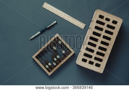Building Industry Accounting Background. Creative Background With Thematic Objects On A Dark Turquoi