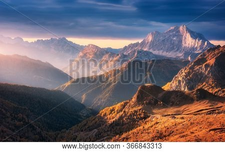 Beautiful Mountains At Sunset In Autumn In Dolomites, Italy. Landscape With Rocks, Sunbeams, Forest,