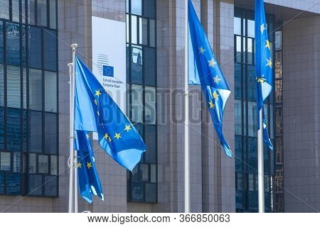 Brussels, Belgium - Fourth Of May 2020 : European Council. European Flags Floating In Front Of The E