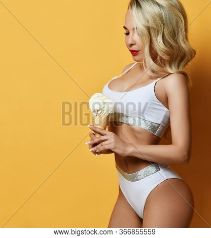 Beautiful Smiling Sexy Fitness Blonde Woman In White Swimsuit Or Underwear Looking At Big Ice-cream