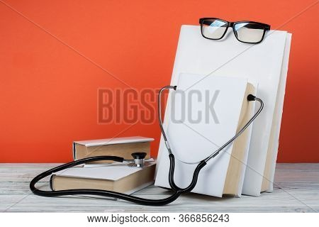 Medical Prescription Blank Paper Form For Patients Record With Doctors Stethoscope Books, Reference