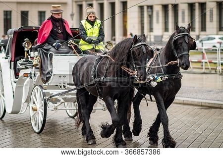 Berlin / Germany - February 18, 2017: Tourist Horse Chariot On Pariser Platz In Berlin, Germany