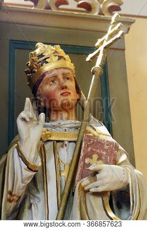 KAMANJE, CROATIA - JULY 02, 2016: Saint Fabian, statue on the altar of St. Anthony in the Parish Church of the Holy Name of Mary in Kamanje, Croatia
