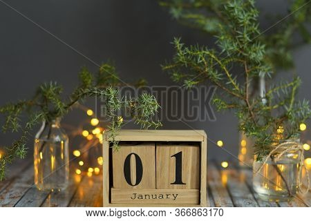 Wooden Calendar 1 January With Christmas And New Year Decorate On Wooden Background,the Concept Of H