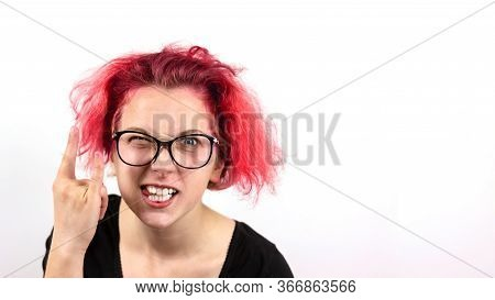 A Girl Rocker With Red Hair And Glasses Squinting One Eye Shows A Hand Gesture Heavy Metal Hm On A W