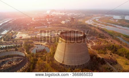 Chernobyl Nuclear Power Plant. Cooling Tower Overlooking The Nuclear Power Plant In Chernobyl. Chern