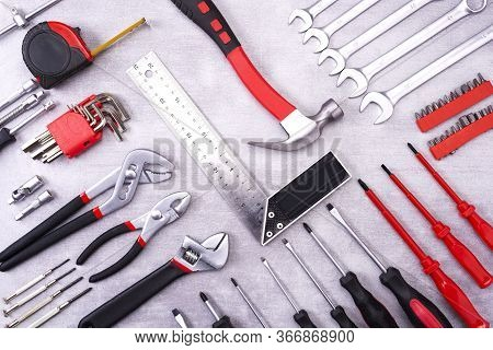 Coplet Of Repair Tools On A Gray Background. Equipment For Construction. Repair Tool Kit. View From