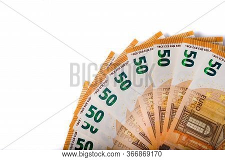 Banknotes Of 50 Euros Laid Fan. Copy Space On White Background. Euro Banknote As Part Of The Economi