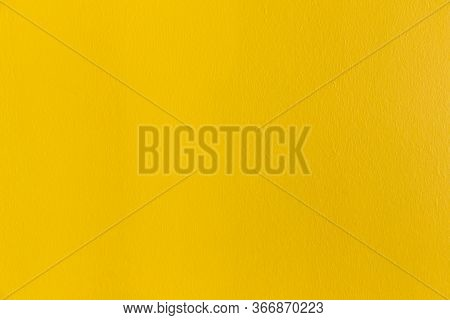 Yellow Wall Texture. Yellow Cement Or Concrete Wall Texture For Backgrounds. Empty Space. Vivid Yell