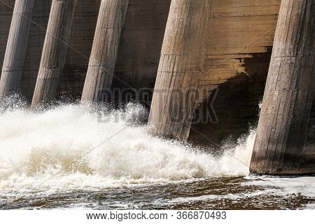 Structures Of The Old Dam On The River Splashing Water Falling Through An Open Lock Side View. Summe