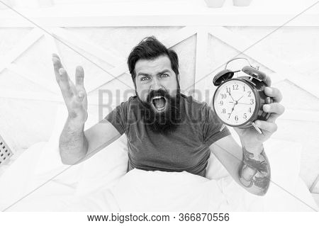 Feeling Tired And Stressed. Stressed Man Shouting At The Alarm Clock. Hate Noise Of Alarm Clock. Man