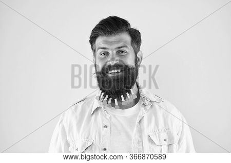 Hipster Fashion. Brutal Male Put Clothespin With Hearts On Beard. Bearded Man Hipster Casual Style.