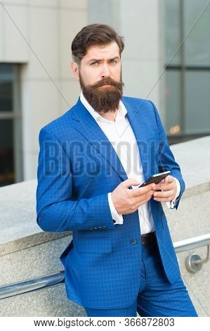 Text Messaging. Bearded Man With Smartphone. Handsome Cool Businessman Using Smartphone. Send Messag
