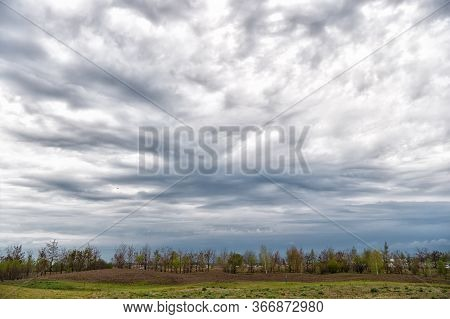 Living In Harmony With Nature. Sky And Clouds. Cloudy Sky Background. Field And Forest Landscape Und