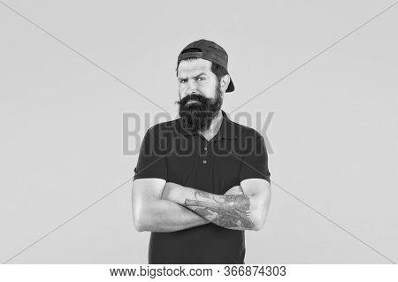 Barber Salon And Facial Hair Care. Masculinity. Hipster Life. Brutal Handsome Hipster Tattooed Man.