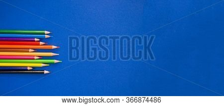 Colorful Pencils On Blue Background With Copyspace. 2020 Color Trend. Banner With Copyspace.