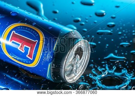 Bedford, Uk, May 17, 2020. Fosters Premium Lager Can With Splashes Of Water On A Black Background An