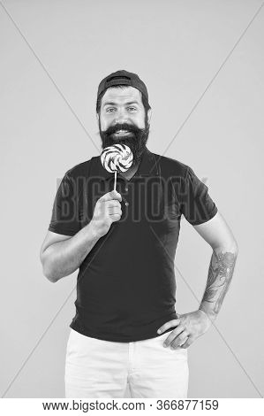 Sweet Taste. Happy Hipster Eat Lollipop Candy. Candy Shop. Sweet Boy. Taste Of Childhood. Happy Eati