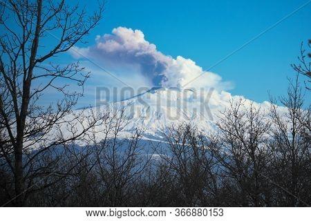 smoke from snow covered Volcano Etna of Sicily natural landmark