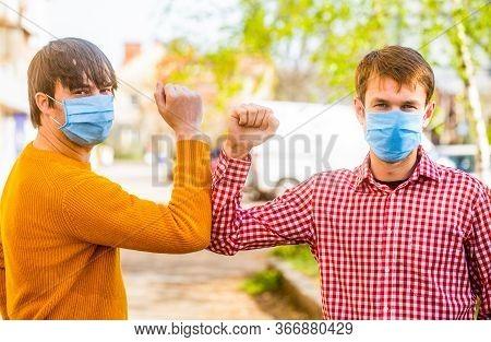 Coronavirus, Illness, Infection, Quarantine, Medical Mask. Friends Medical Mask. Elbow Bump. Elbows