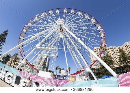 Adelaide, Australia - March 8th, 2020:the Ferris Wheel On The Beach Of Adelaide, Australia, On A Sun
