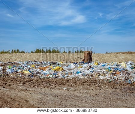 The Top Layer Of The Waste Landfill With A Pipe For The Removal Of Gas From Inside The Landfill