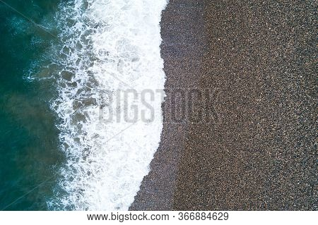 Vacation And Travel Concept. Aerial Image Of Pebble Beach Natural Background. Camera Looks Straight