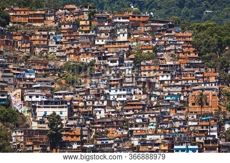 Red Brick Houses Of The Poor In Favela In Rio De Janeiro, Brazil