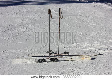 Ski Equipment, Skis And Ski Poles On The Snow On The Mountain Slope, Ski Resort In Winter