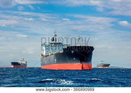 Logistics and transportation of International Container Cargo ships in the sea near harbor at calm day, Freight Transportation, Shipping