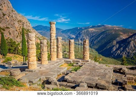 Famous Ancient Ruins - The Temple of Apollo in Delphi, Greece in a summer day, European travel