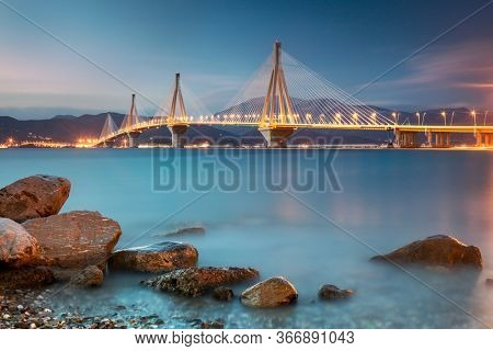 Modern Bridge at the  night time with lights. Rion-Antirion Bridge, Greece, Europe. The Rion-Antirion Bridge in Greece one of the world's longest multi-span cable-stayed bridges