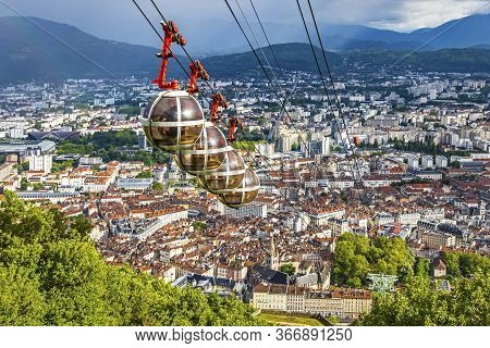 Picturesque Aerial View Of Grenoble City, Auvergne-rhone-alpes Region, France. Grenoble-bastille Cab