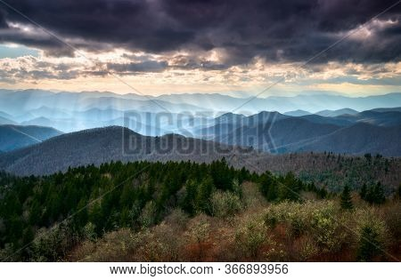 Late Afternoon Sunbeams Shine Down On The Mountain Peaks And Ridges From A Scenic Overlook Along The