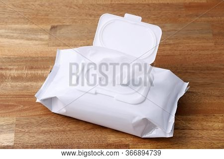 Packaging Wet Tissue Paper On Wooden Table