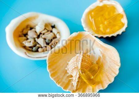 Omega 3 Capsules On Shell, Sea Salt And Fish Oil Pills