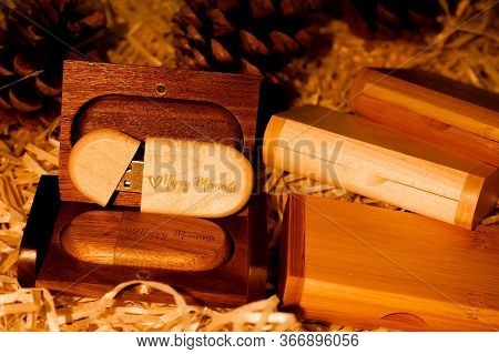 Wooden Brown Usb Flash Drive With Text Happy Moments With Cones, Brown Warm Background, Data Storage