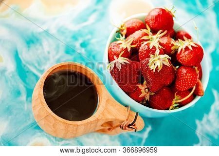 Red Juicy Ripe Strawberries In A Blue Vase On A Light Background On A Blue Stand Made Of Epoxy Resin