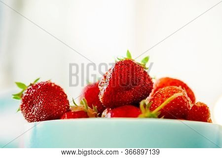 Red Juicy Ripe Strawberries In A Blue Vase On A Light Background. Healthy Spring Breakfast, Fruit Pl