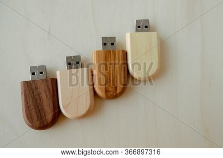 Set Of Wooden Brown Usb Flash Drive, Wooden Packaging. Light And Dark Wood, Data Storage, Beautiful