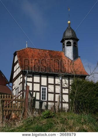 Timbered village church in Harbshausen near Edersee Germany poster