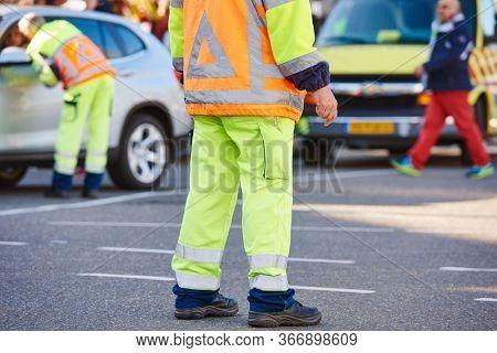 Traffic control manager watching urban street order