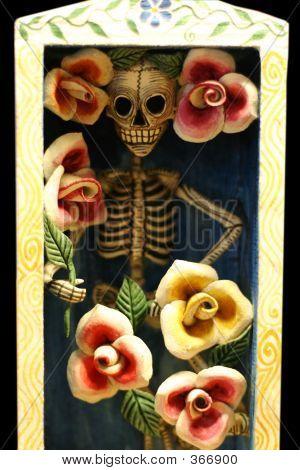 dia de los muertos (day of the dead) doll in it's coffin poster