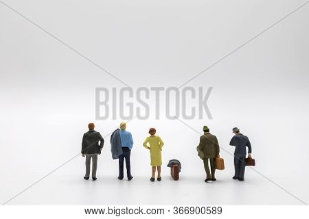 Business And Travel Concept. Group Of Businessman And Businesswoman Miniature Figure People With Jac