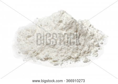Heap of white wheat flour close up  isolated on white background