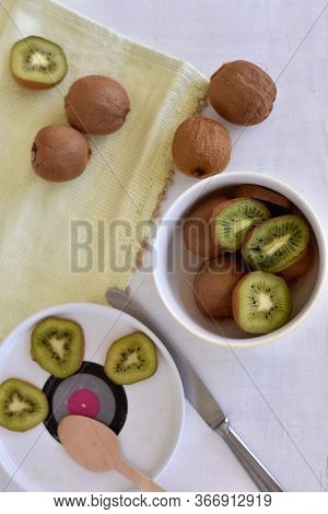 Healthy Nutrition/ Delicious Ripe Kiwi Fruits In A Ceramic Bowl/ Healty Eating Or Helathy Lifestyle/