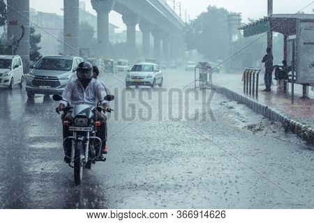 New Delhi, Delhi/ India- May 19 2020: Vehicles On Road When Ir Rained In Delhi, Monsoon Arrives In D