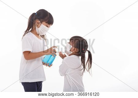 Two Little Girls  Wear Facemask During Coronavirus And Flu Outbreak. Virus And Illness Protection, H