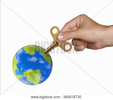 Hand turning mechanic handle to recharge the planet earth concept on white background.